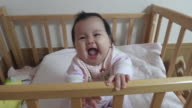 Japanese baby smile on the bed