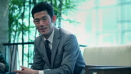 Japanese Businessman Sitting in Chair