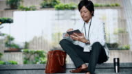 DS Japanese businessman using a digital tablet
