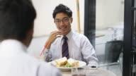 MS Japanese businessmen talk over lunch / Tokyo, Japan