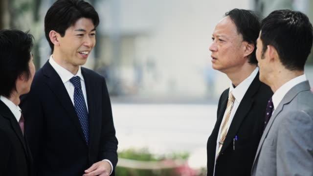 Japanese Businessmen Talking