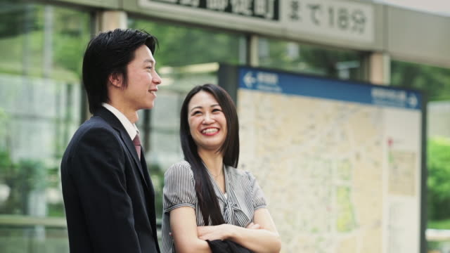 Japanese Businesspeople Waiting for Someone