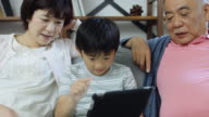 Japanese Family Playing with Tablet