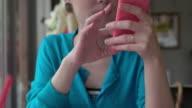 Japanese female using smartphone.