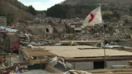 Japanese Flag flying in Onagawa town in in Oshika District, Miyagi, Japan on 3rd April 2011, 3 weeks after a tsunami hit North East Japan, caused by magnitude 9 Tohoku.