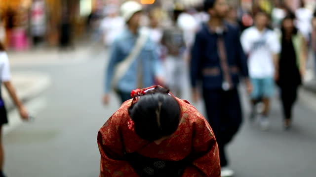Japanese Girl in a Kimono Bowing in Shibuya