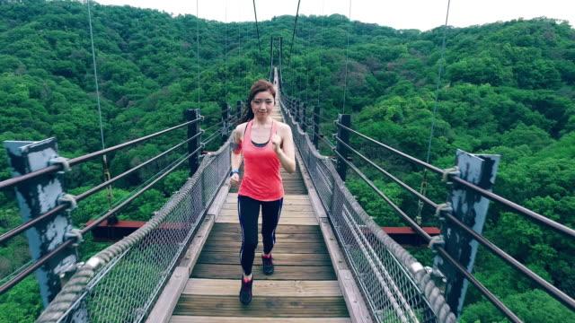 Japanese girl sports training among nature