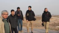 Japanese journalists wait in front of Akcakale border gate on TurkishSyrian border crossing to welcome their colleague Kenji Goto captured by Islamic...