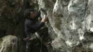 A Japanese man rock climbing