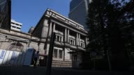 A Japanese national flag flies outside the Bank of Japan headquarters in Tokyo Japan on Wednesday Sept 13 The Bank of Japan headquarters stand in...