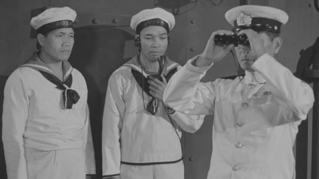 MS Japanese officers commanding to crew on deck of ship