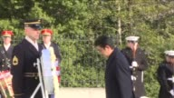 Japanese Prime Minister Shinzo Abo arrives at Arlington cemetery to place a wreath at the Tomb of the Unknown Soldier before talks with US President...
