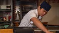 CU, Japanese restaurant chef  serving sushi