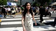 Japanese Woman Crossing Shibuya With Everyone Else Walking Backwards