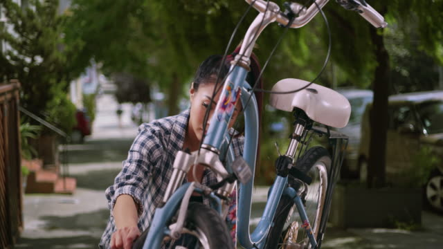 Japanese woman giving her bicycle a quick tuneup