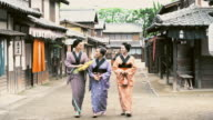 DS Japanese women in traditional clothes walking in the village