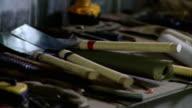 CU Japanese wood saws on counter in workshop, Live Oak, Florida, USA