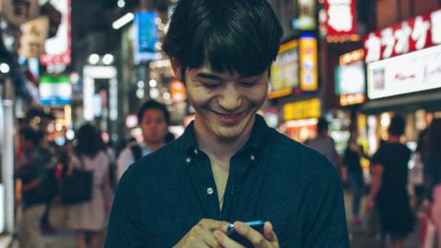 Japanese young man using mobile phone