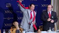 Japan's Antonio Inoki a wrestler turned senator unmistakable with his outsized chin and trademark tie and red scarf even in summer is the latest...