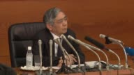 Japan's central bank hikes its economic growth forecasts citing an improved global outlook and a weaker yen but the country's finance chief warned of...