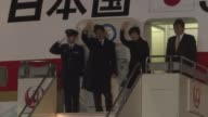 Japan's Prime Minister Shinzo Abe and his wife Akie leave Haneda Airport in Tokyo for Washington DC