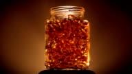 Jar of Gold Coloured Vitamins Lid Off