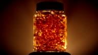 Jar Of Gold Coloured Vitamins