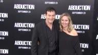 Jason Isaacs Emma Hewitt at the 'Abduction' Premiere at Hollywood CA