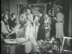 MS 'Jeanne Lanvin' sign on building designers female male for Lanvin fashion house examining elegant strapless dress on model removing cape checking...