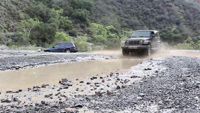 Jeep Splashing Into Mud