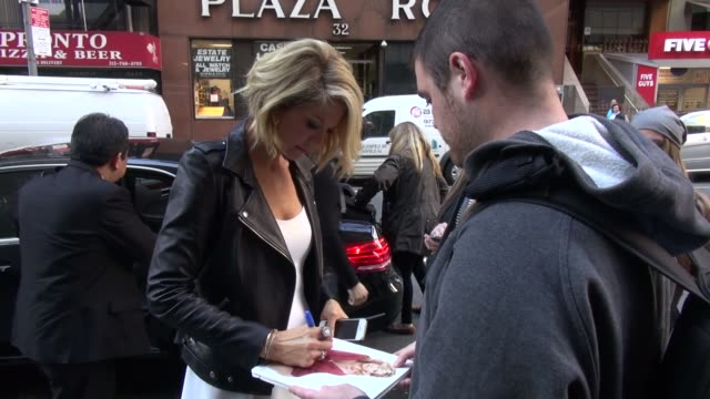 Jenna Elfman arrives at the Today show in Rockefeller Center and signs for a fan in Celebrity Sightings in New York