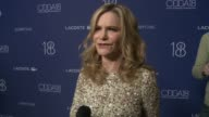 INTERVIEW Jennifer Jason Leigh on the event at 18th Costume Designers Guild Awards with Presenting Sponsor LACOSTE in Los Angeles CA