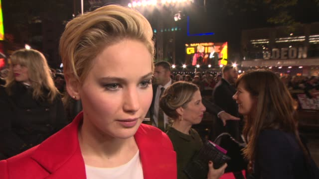 INTERVIEW Jennifer Lawrence on the worlds reaction to her haircut at 'The Hunger Games Catching Fire' Premiere on November 11 2013 in London England