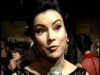 Jennifer Tilly talks to reporter about why people support the ball and what she's wearing on red carpet