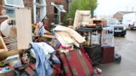 Jenny Kay removes flood damaged property from her house on Warwick Road in Carlisle Cumbria on Tuesday 8th December 2015 after torrential rain from...