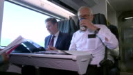 Jeremy Corbyn and Keir Starmer riding on a train