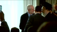 Jeremy Corbyn Speech on antiSemitism Report **MUSIC Jeremy Corbyn MP walks towards Rabbi Pinter and shakes hands / press and audience stand / Corbyn...