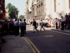 ENGLAND London Old Bailey EXT George Deakin leaves court with wife / John Le Mesurier out and into taxi vquickly / Thorpe out and surrounded by crowd...