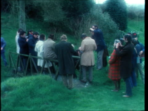 Jeremy Thorpe on election day ENGLAND Devon Cobbaton Jeremy Thorpe and wife out of house and along to garden Thorpe sitting on fence with reporters...
