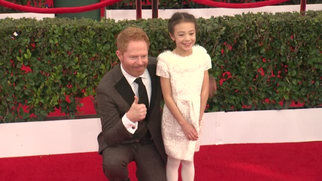 Jesse Tyler Ferguson and Aubrey AndersonEmmons at the 21st Annual Screen Actors Guild Awards Arrivals at The Shrine Auditorium on January 25 2015 in...