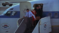 MS TD Jet airplane flight door opening and passengers start to leaving airplane