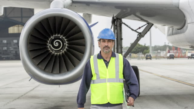 Jet engineer walking towards camera