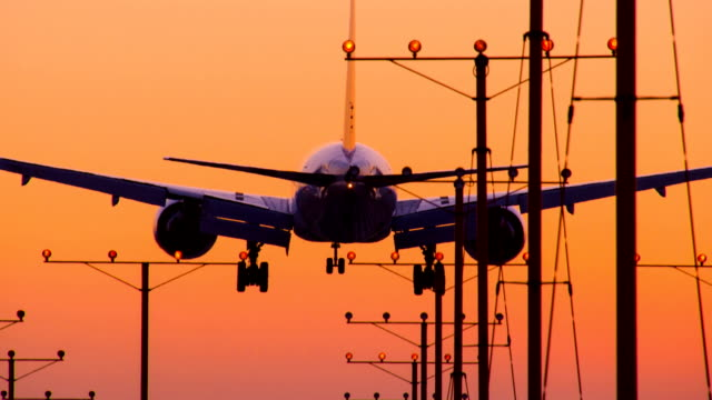 Jet Landing Airport Sunset