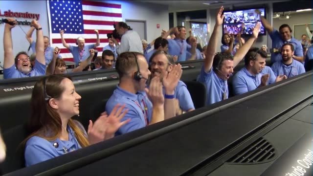 / Jet Propulsion Laboratory employees watch as Mars Curiosity Rover successfully lands on Mars surface / interspersed with animation of the landing...
