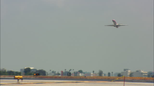 WS, LA, Jet taking off from Los Angeles International Airport, Los Angeles, California, USA