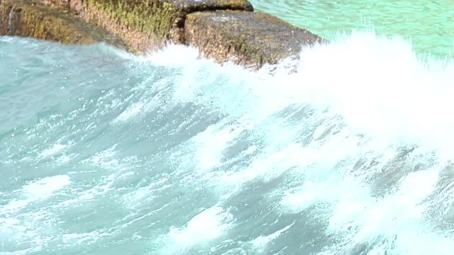 Jetty with foamy waves