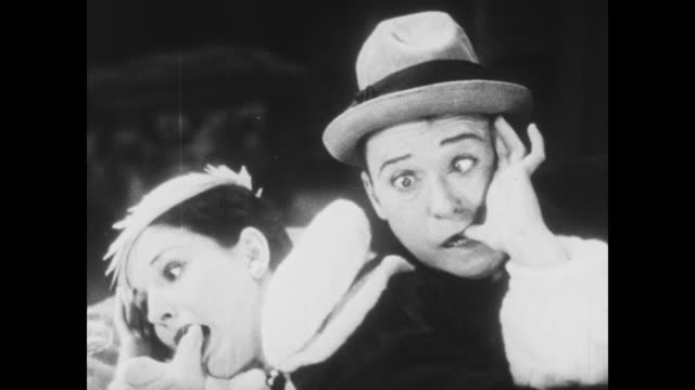 Jewel thief hides with Harry Langdon in wax museum, endures pin prick test of searching police officer