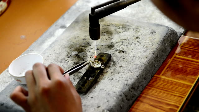 Jeweller making a decoration