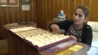 Jewelry store owner in Antakya Turkey works on product display in souk