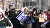 Jewish flag and people partaking in the antiterror protest held at Nathan Phillips Square despite the cold weather in the capital city of the...